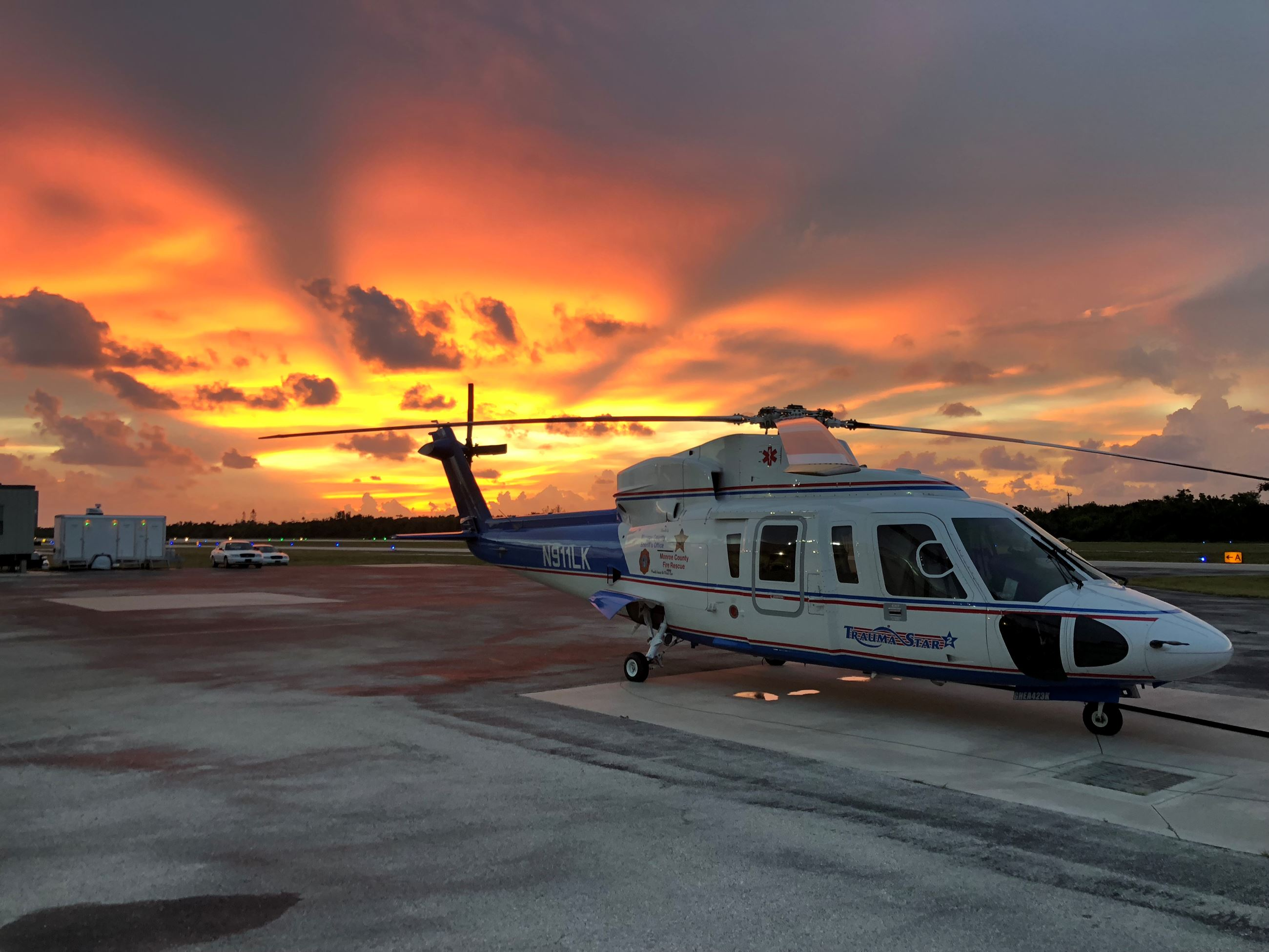 Photo of Trauma Star air ambulance at Marathon hangar during sunset