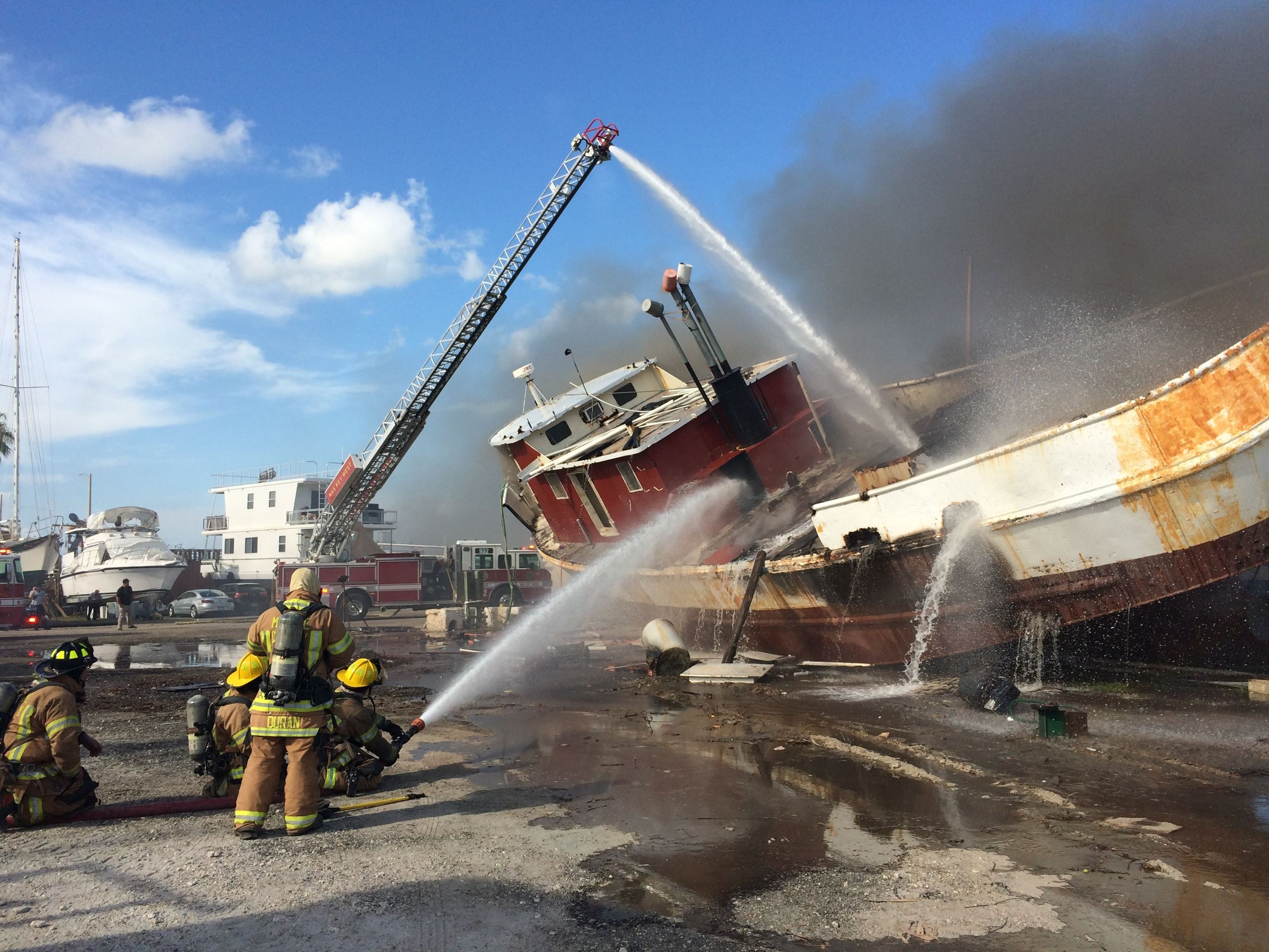 Shrimp boat on fire at Stock Island marina